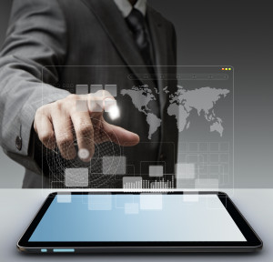 """business man hand touch virtual screen computer interface as concept""""Elements of this image furnished by NASA"""""""